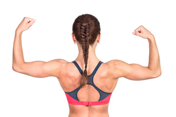 Athletic young woman showing muscles of the back and hands