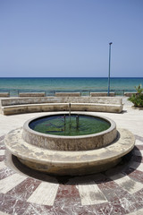 Italy, Sicily, Donnalucata, public fountain on the seafront