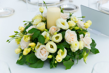 white pink and yellow roses flowers on table for a wedding