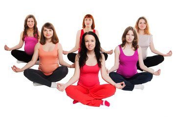 group of six pregnant women doing yoga