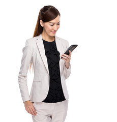 Young business woman reading mobile phone isolated