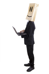 Anonymous businessman using laptop