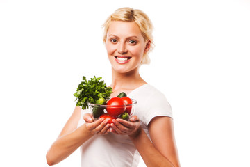 Close-up of pretty girl holding fresh vegetable salad in glass