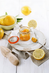 Lemon curd over white wooden background
