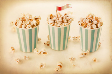 Retro popcorn in a striped cups