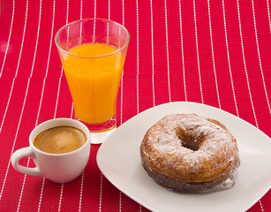 Cronut, coffee and orange juice