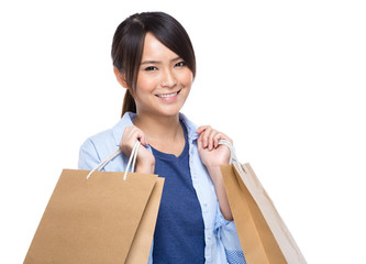Asian young woman with shopping bag on white background