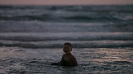 little boy running around evening sea in Israel. Mediterranean