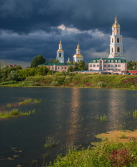 Storm over Trinity Monastery on lakeside in Diveevo