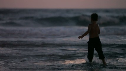 little boy running around evening sea in Israel. Mediterranean
