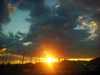 Golden sunset over the Olympic Port of Barcelona