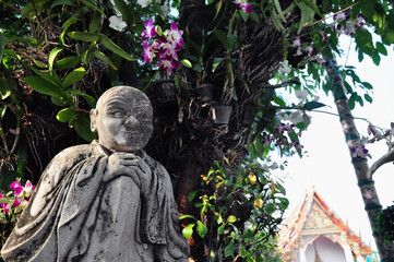 Buddhist statues and orchids
