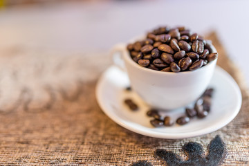 Cup with coffee beans on a saucer
