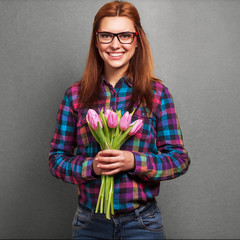 girl wearing hipster surprised donation of a bouquet of flowers