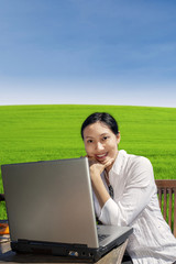 Businesswoman work with laptop in park