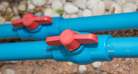 Blue PVC pipe and  valve