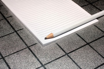 pencil and paper for notes as part of office supplies