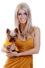 Blonde girl with a cute little dog Yorkshire terrier