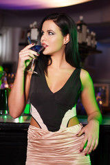 woman drink martini in bar