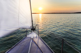 Sailing to the sunset with a luxury yacht. poster