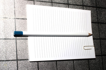 paper clip, pencil and paper for notes as of office supplies
