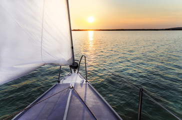 Sailing to the sunset with a luxury yacht.