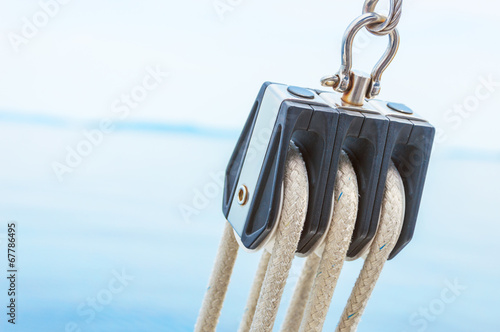 Closeup of pulley on sailing - 67786495