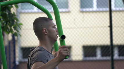 Man exercising on machine in outdoor gym
