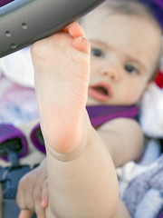 bare foot of baby girl  resting on stroller