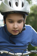 Close-up of a cute boy on bike