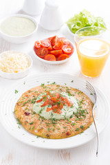 healthy breakfast - omelette with carrots, tomatoes