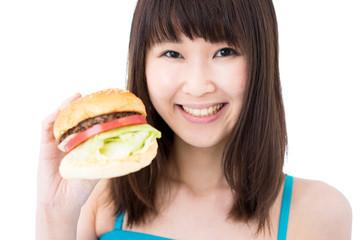 ハンバーガーを持った女性