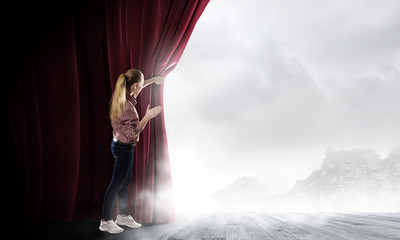 Woman looking out from curtain