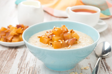 oatmeal with caramelized peaches, tea and yogurt, close-up