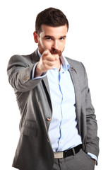 young business man pointing to the camera on white background