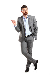 Happy business man presenting with copy space for your text