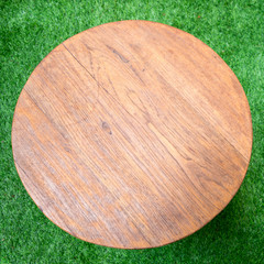 Circle Wood Table on a grass floor