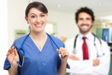 Portrait of two attractive medical workers