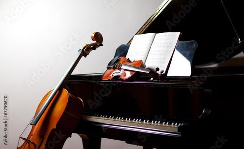 Fotobehang Muziekwinkel Classical music concept: cello, violin, piano and a score