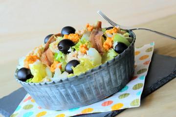 Escarole salad with anchovies, cod and tuna fish