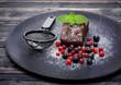 Chocolate cake brownie with summer berries on dark background
