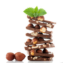 Chocolate with hazelnuts and mint leaves