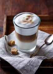 Glass of Latte Macchiato with Brown Sugar