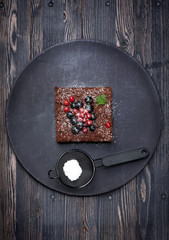 Chocolate cake Brownies with berries
