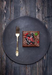 Chocolate cake brownie with summer berries
