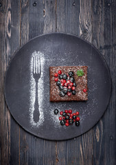 Chocolate cake brownie with summer berries.
