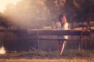 Girl sitting in a bench