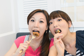 Happy friends eating