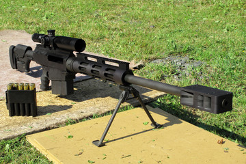Sniper rifle caliber .50 BMG with muzzle brake.