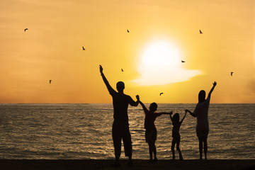 Happy family watching sunset